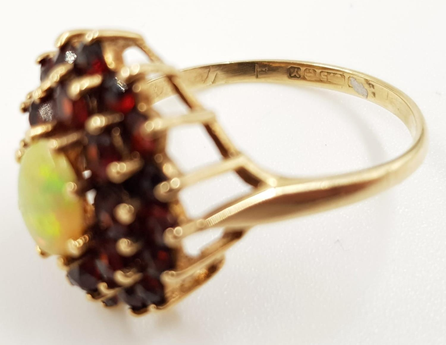 A 9ct gold, fire opal and garnet stone cluster ladies ring. 3.4g total weight. Size P. - Image 3 of 3