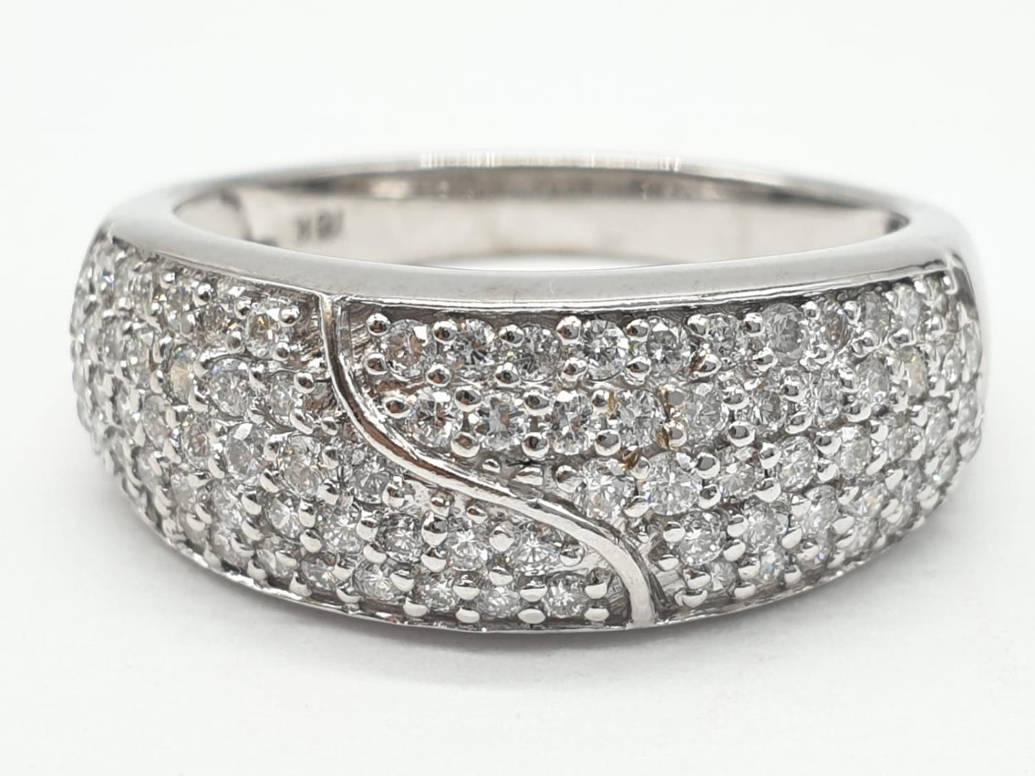 18ct diamond encrusted stylist ring. Weighs 5.6g and is a size O.