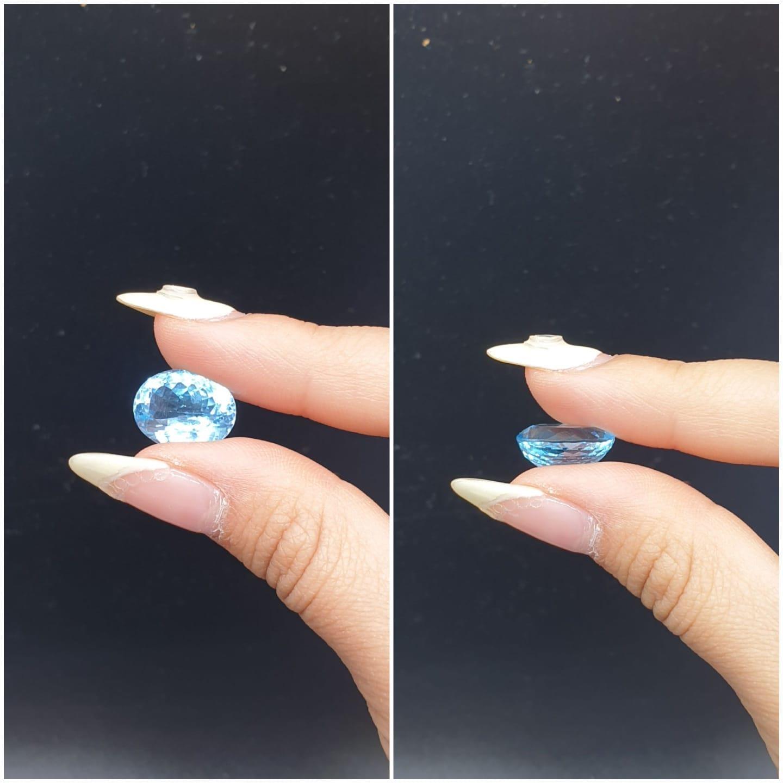 9.40 Ct Natural Blue Topaz. Oval shape. ITLGR certified - Image 5 of 5