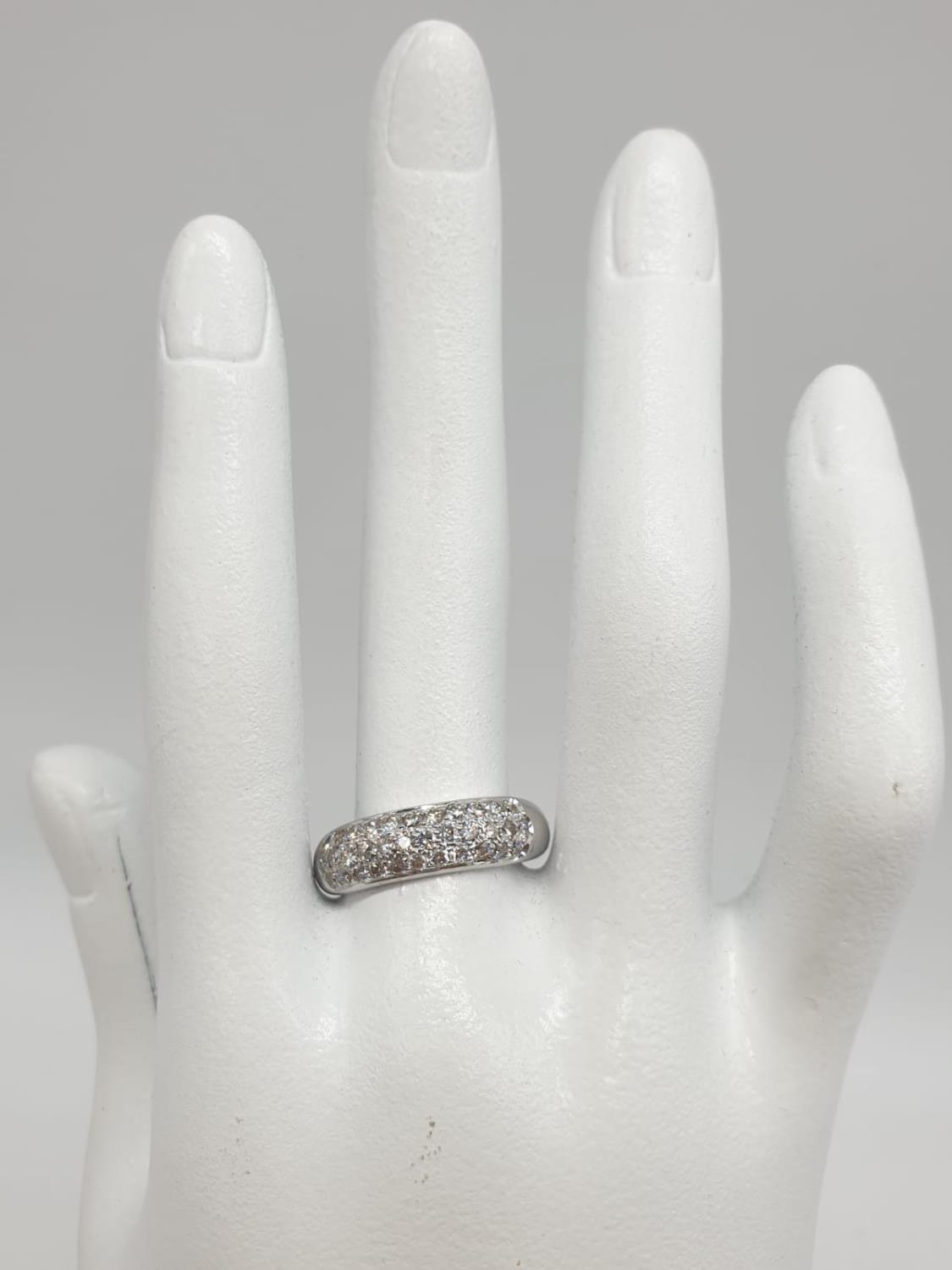 A diamond encrusted 18ct white gold ring. 6.4g and size N. - Image 6 of 7