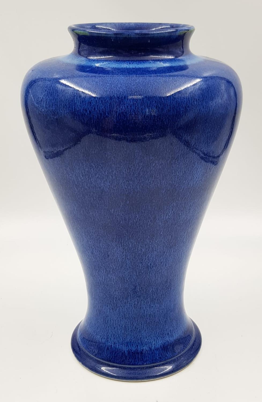 A lovely blue glazed Cobridge stoneware vase. 28cm high.