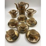 A beautiful decorated Japanese porcelain coffee set, includes coffee pot, cream and sugar jugs