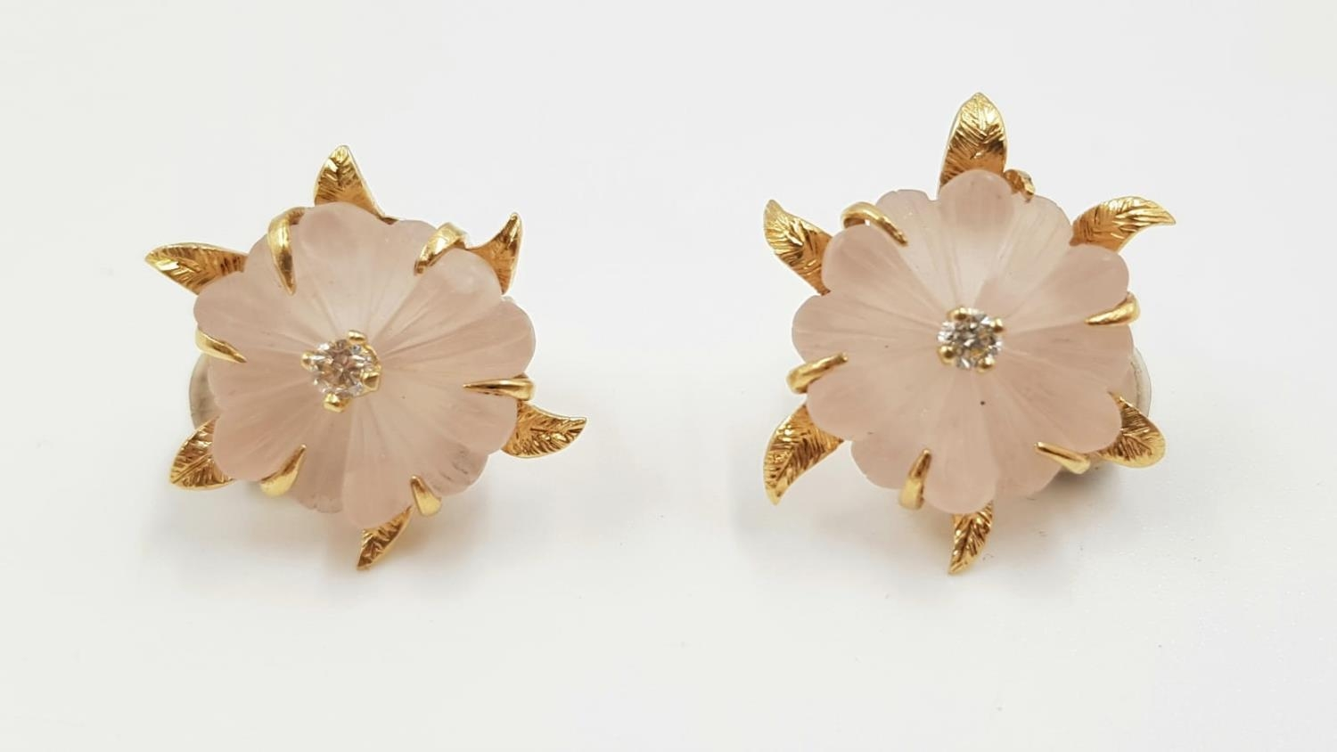 A stunning pair of frosted quartz earrings, each complemented with a small diamond and a 18ct gold