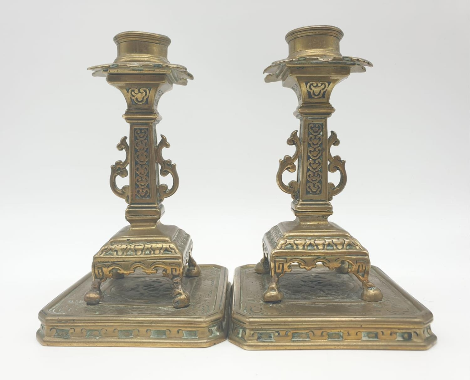 Pair of 19th century Chinese cast candlesticks 16cm tall