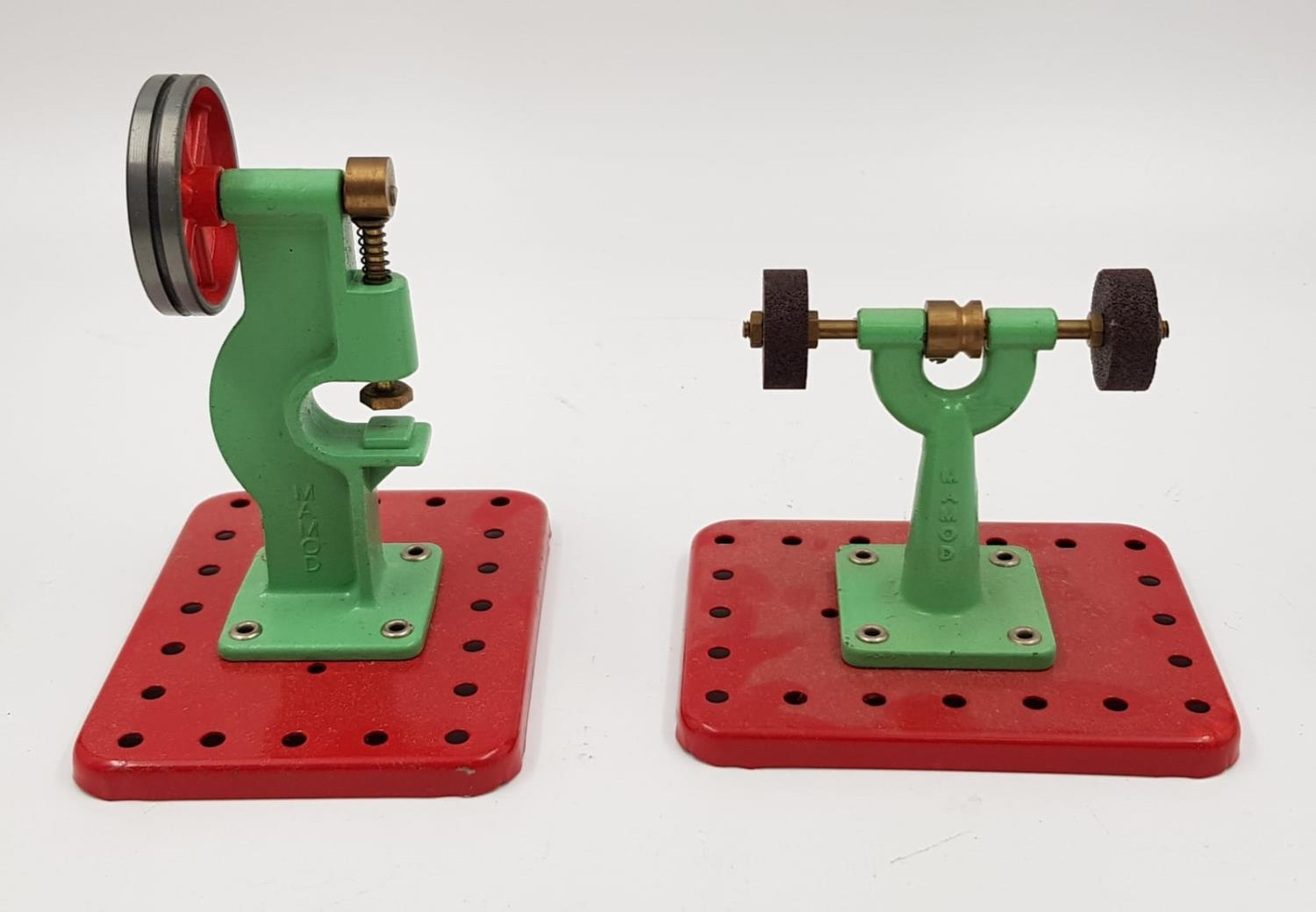 A pair of Momod accessories for their steam engines and Meccano sets. The model power press and