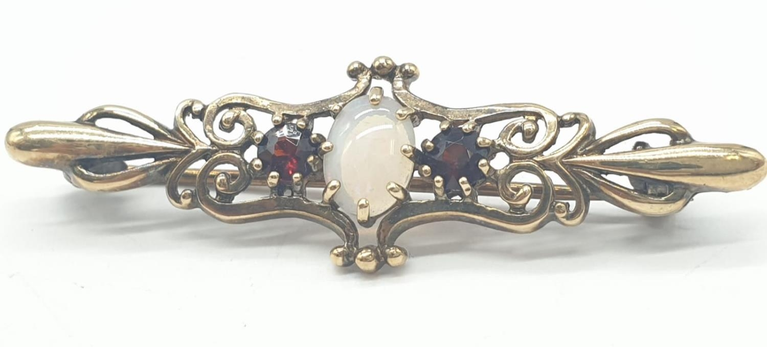 9ct gold opal and garnet bar brooch, weight 2.5g and 4cm long approx