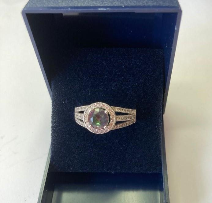 Silver ring with circular Mystic Topaz to top. Marcasite surround with pierced marcasite