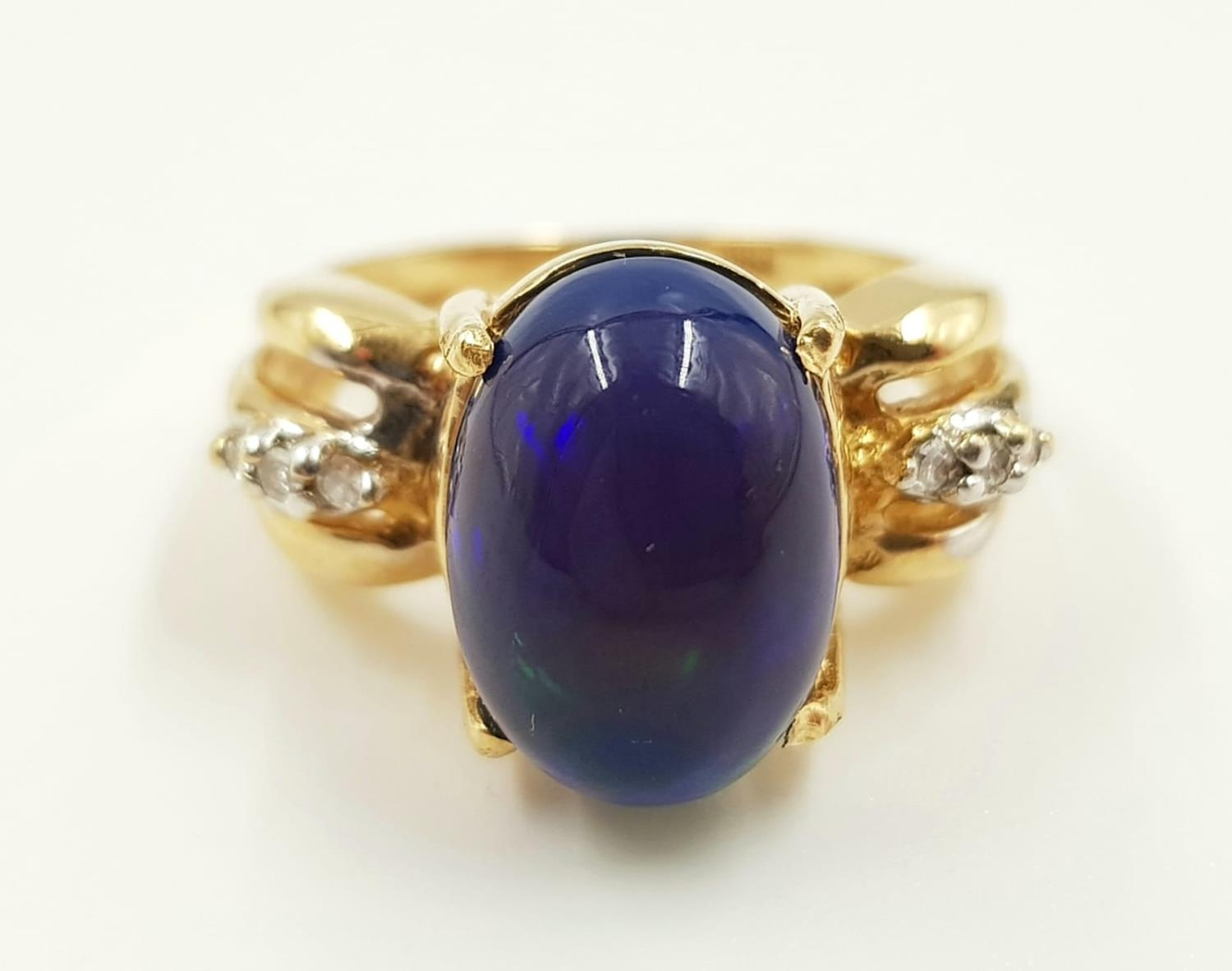 A 14ct gold, opal and diamond ring. 5g total weight and is size M. - Image 2 of 4