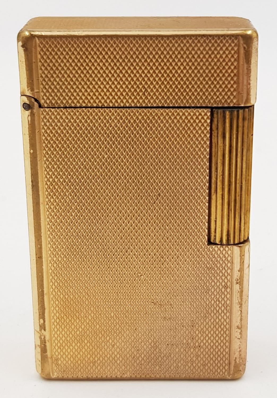 A vintage gold-plated S.T Dupont lighter.