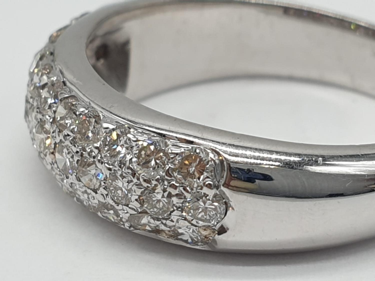 A diamond encrusted 18ct white gold ring. 6.4g and size N. - Image 2 of 7
