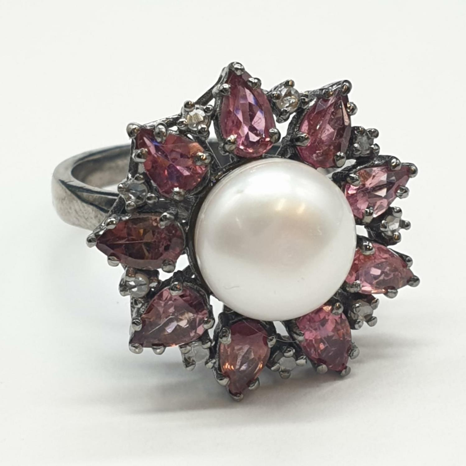 4.40 Cts Pearl & 2.35 Cts Pink Tourmalines set inside a 925 Blackened silver ring. With 0.20 Cts