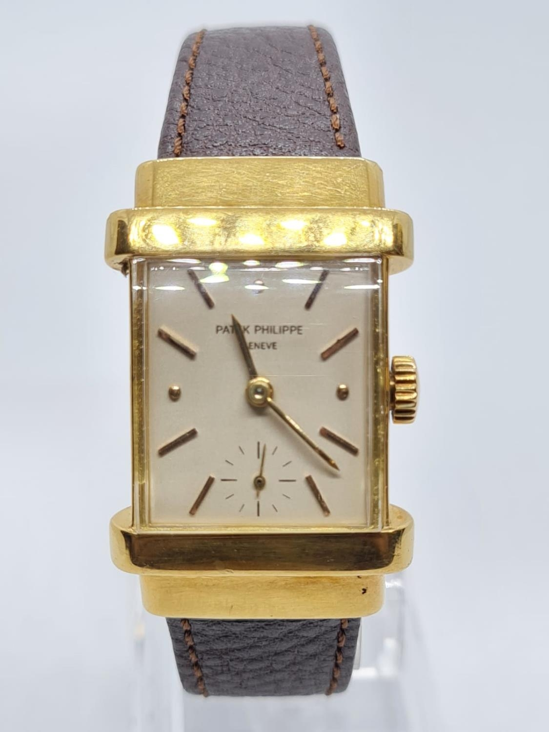 Patek Philippe Geneve WATCH tank style with rectangular face Case: 20x40mm. Brown Leather Strap.