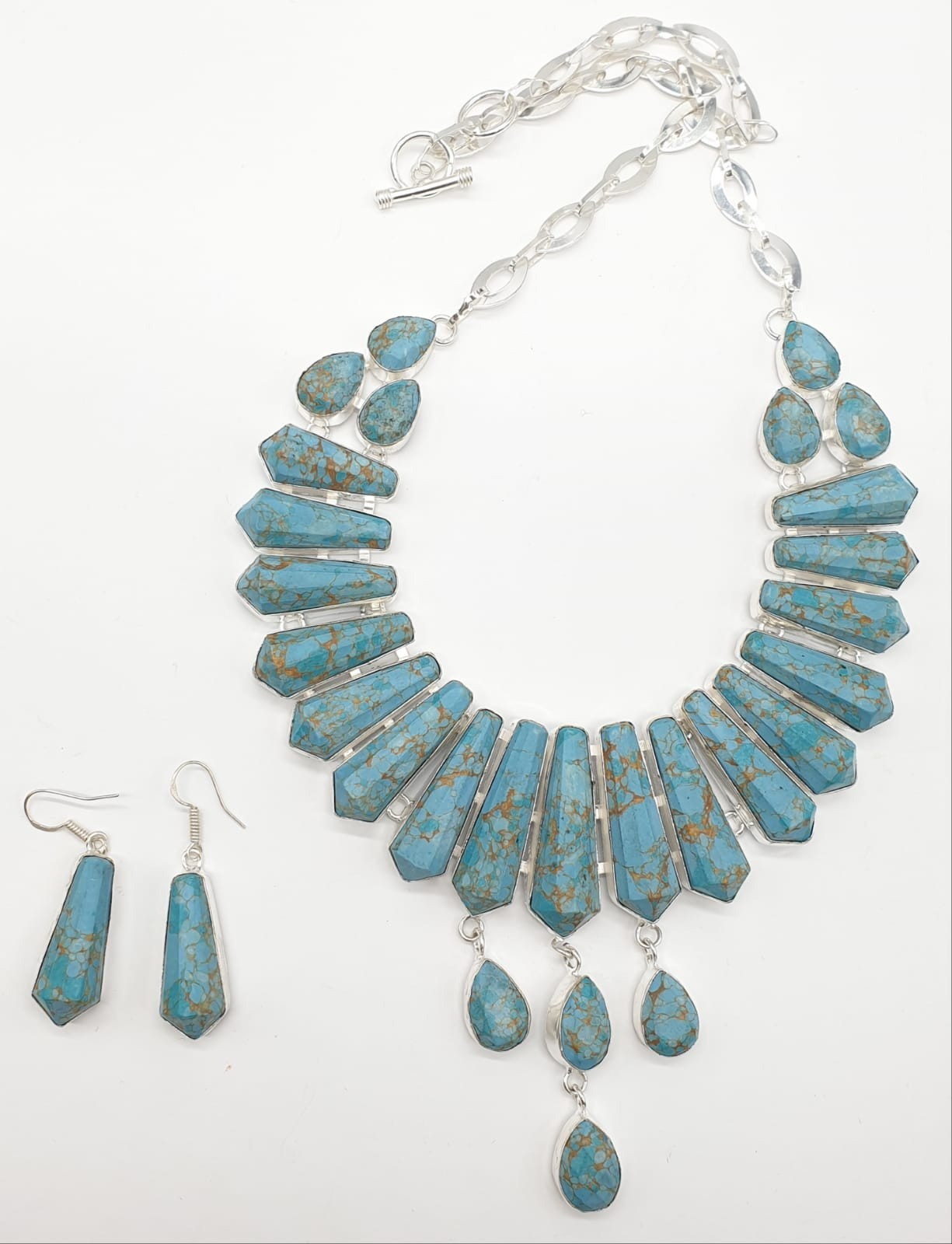 A Pharaonic style necklace and earrings set with light brown-gold veined turquoise obelisks and