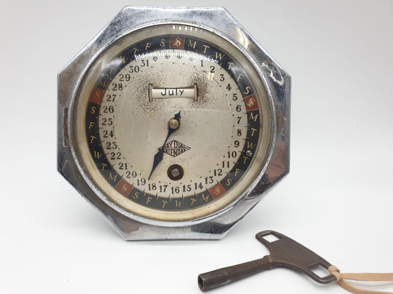 Hofmeier date calender clock with key, 15cm diameter.