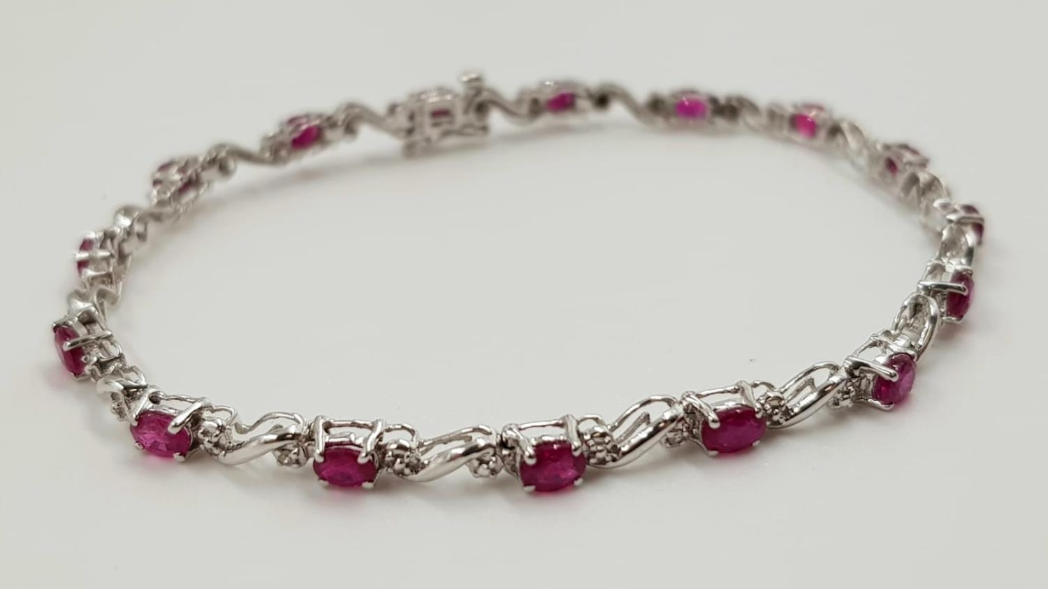 A ruby and diamond ladies bracelet on 9ct white gold. 6.2g total weight and 19cm long.