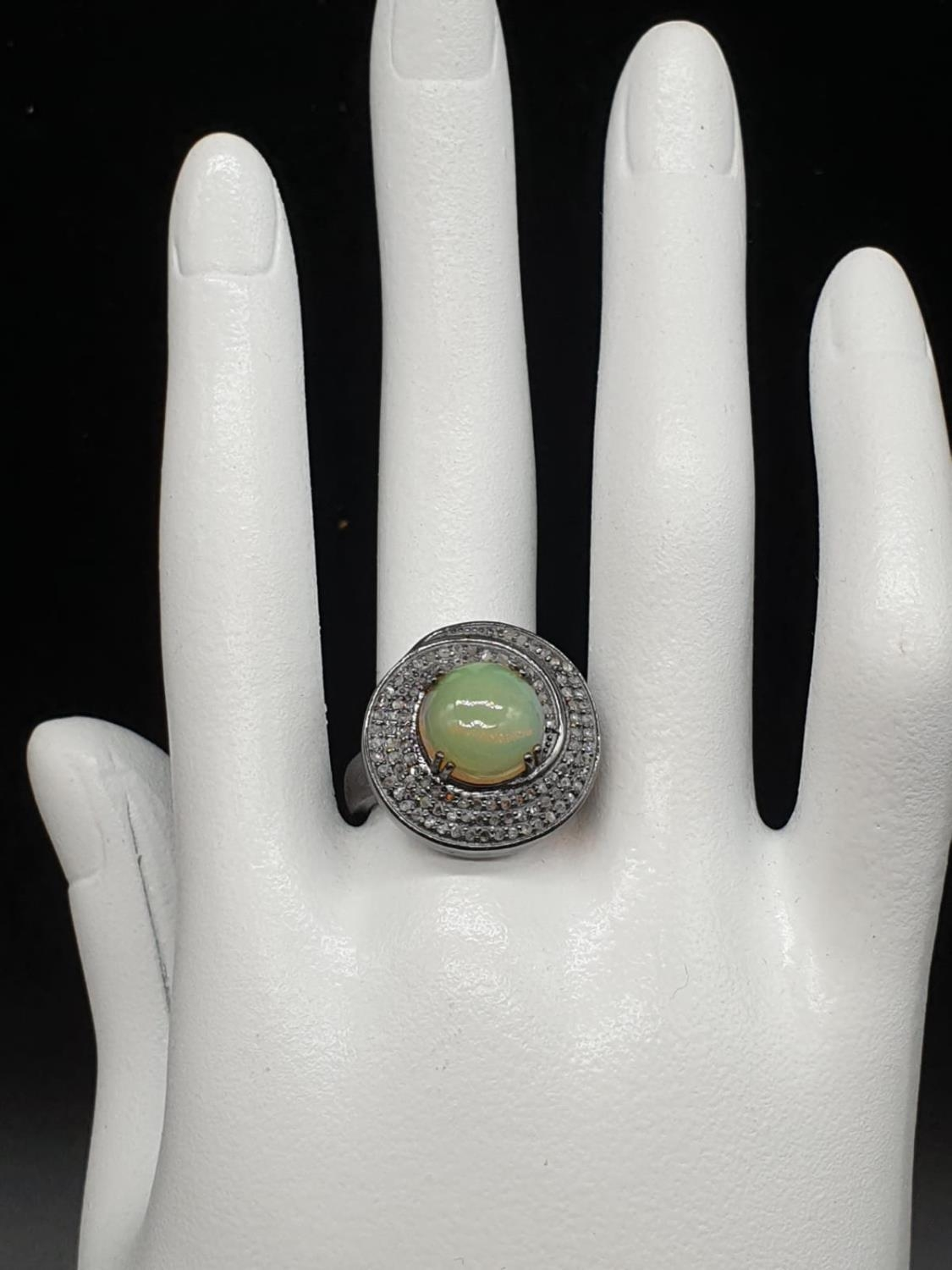 3.50Ct Fire Opal set within a blackened silver ring, with 0.55Ct rose cut diamonds, WEIGHT 6.92G and - Image 5 of 5