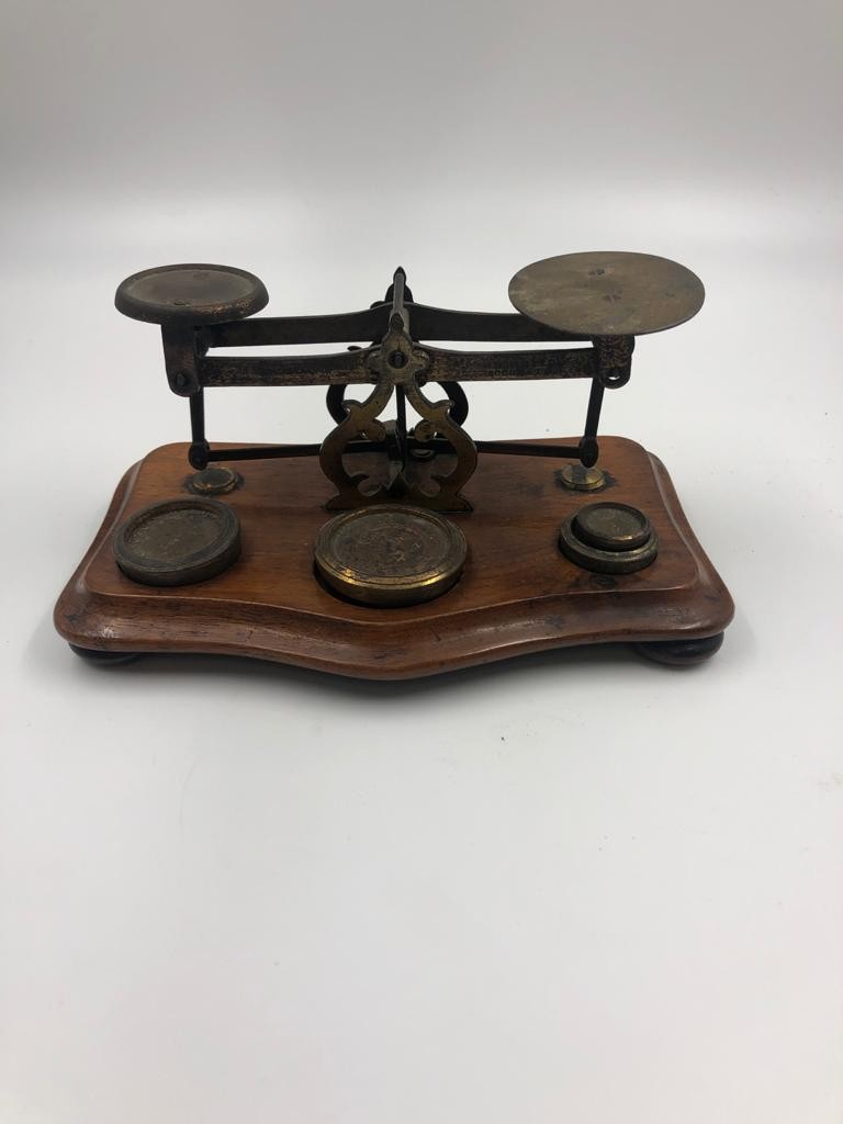 An antique set of postal sealers with original weights, 20x11cm