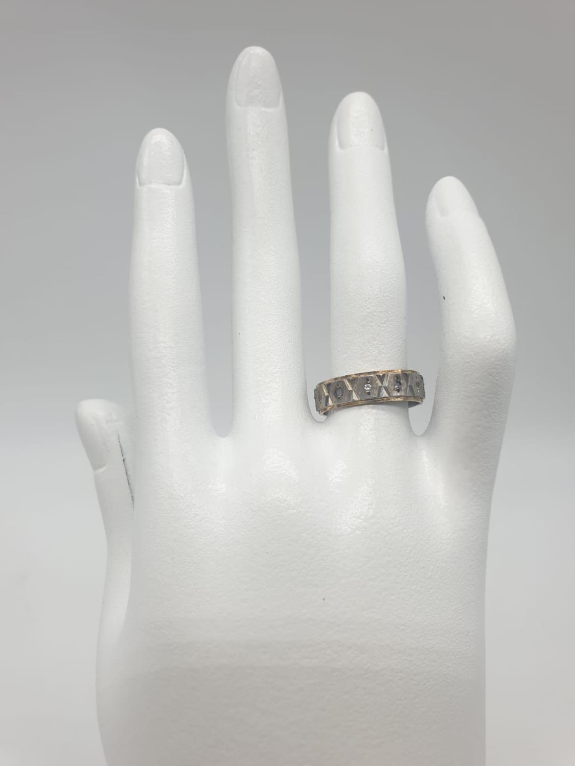 Gold and silver eternity ring, 3.2g weight and size O - Image 4 of 4