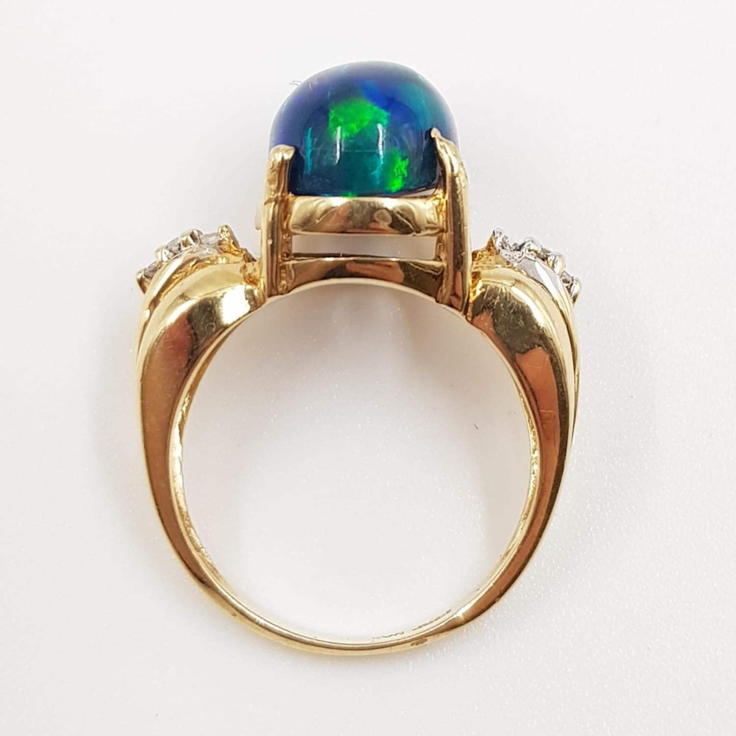 A 14ct gold, opal and diamond ring. 5g total weight and is size M. - Image 3 of 4