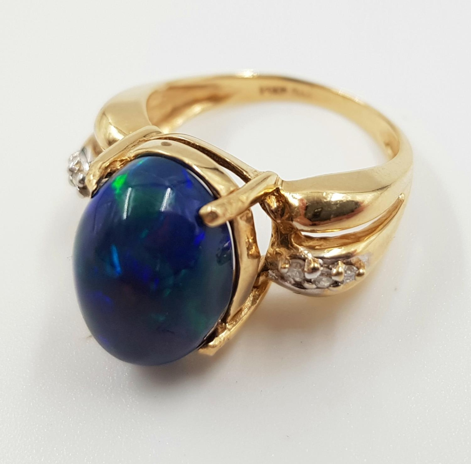 A 14ct gold, opal and diamond ring. 5g total weight and is size M.