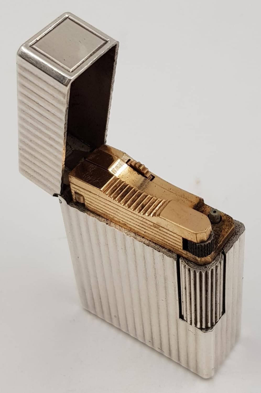 A vintage silver S.T Dupont lighter. - Image 2 of 3