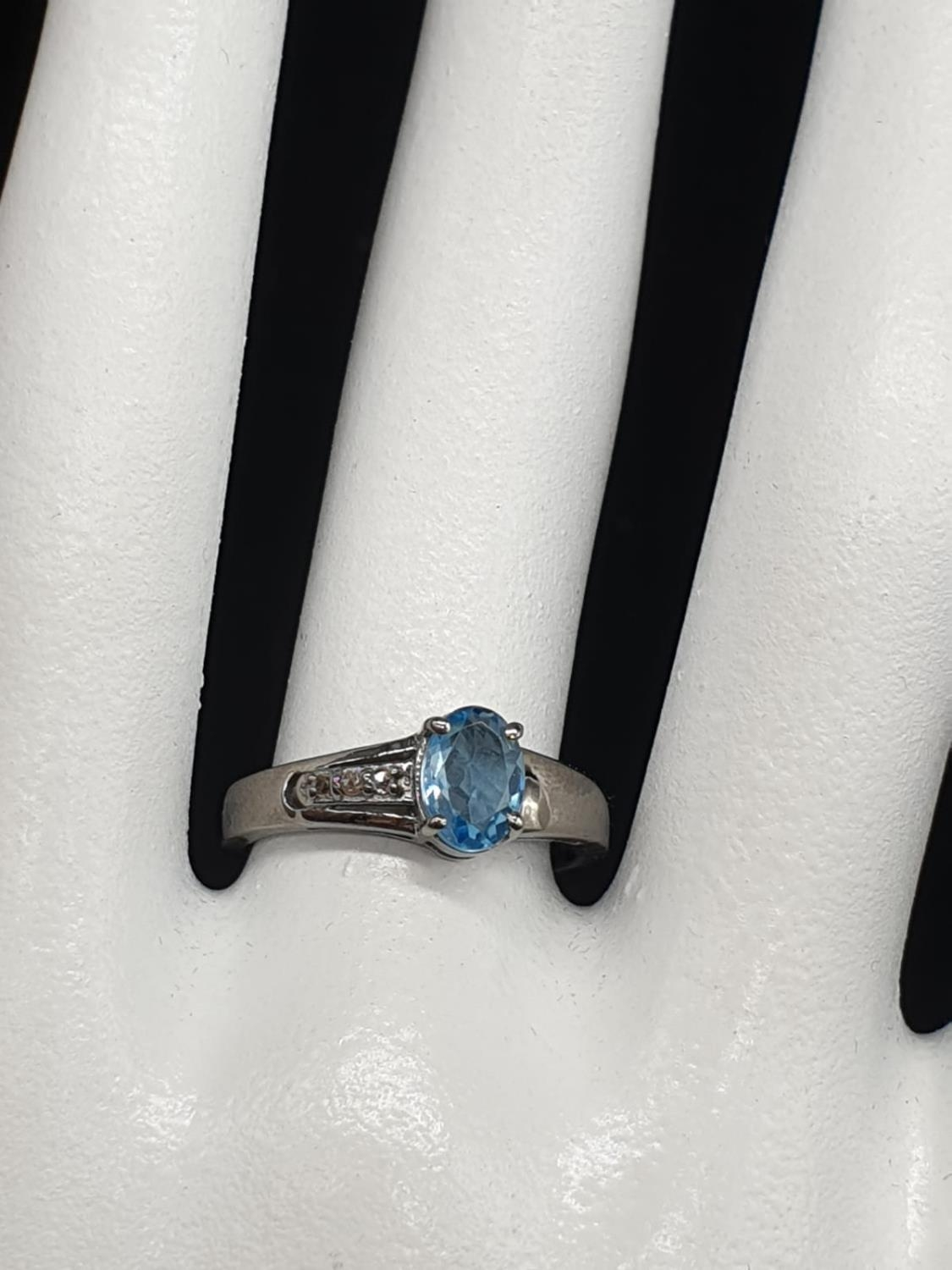 0.86 Ct Blue topaz stone inset a blackened silver ring. With 0.05 Ct rose cut diamonds, weight 2.35g - Image 7 of 7