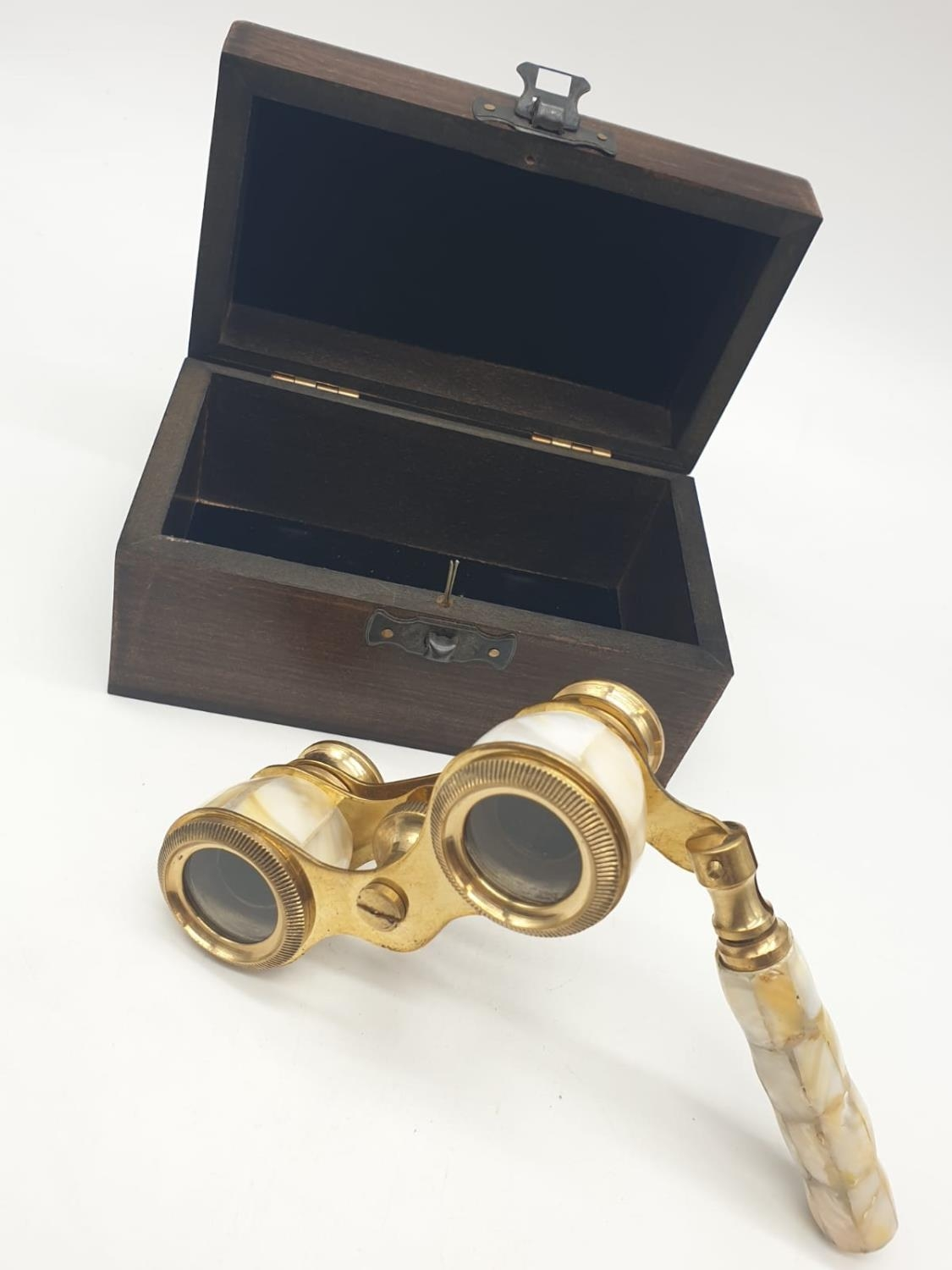 1920's Mother of Pearl & Brass opera glasses with folding handle, in wooden box. 13x7cm.