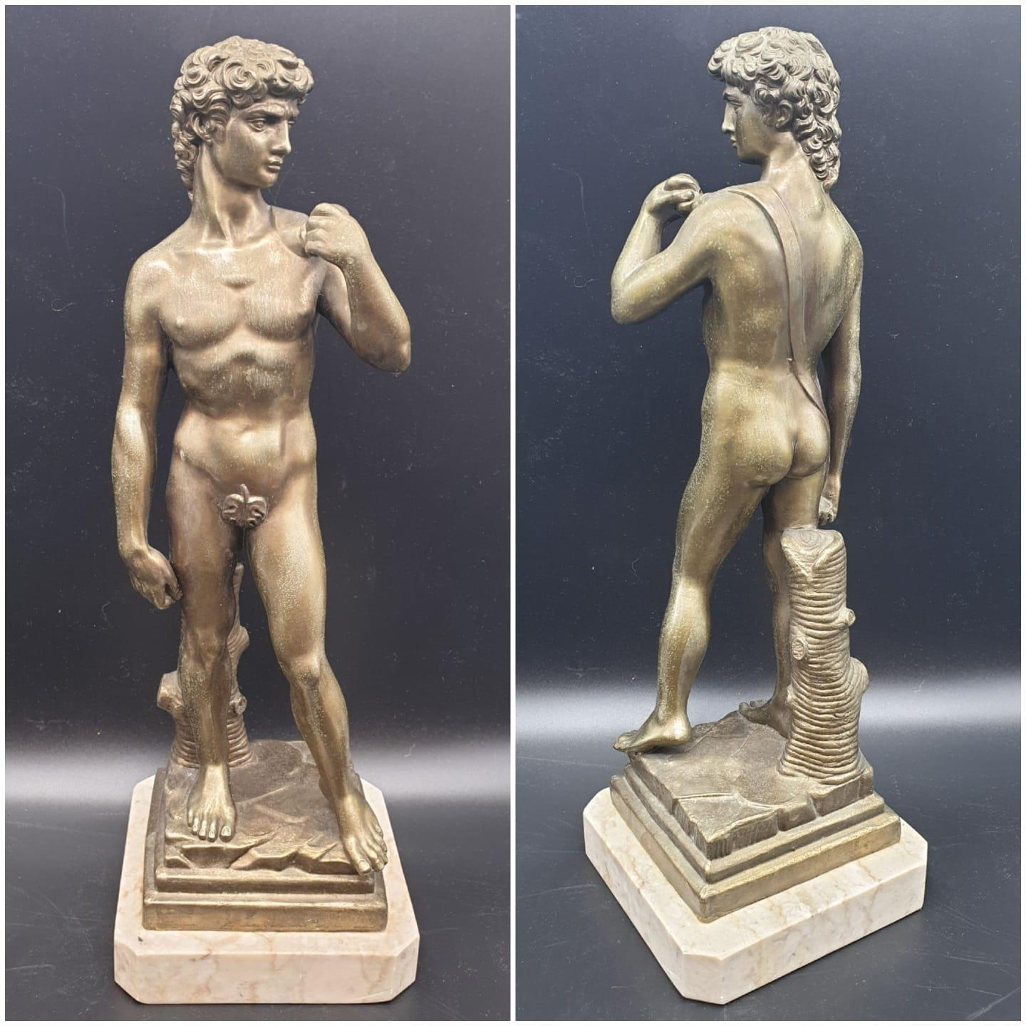 A Statue of Michelangelo's David in Brass on a Marble Base 40cms Tall 3.6kg