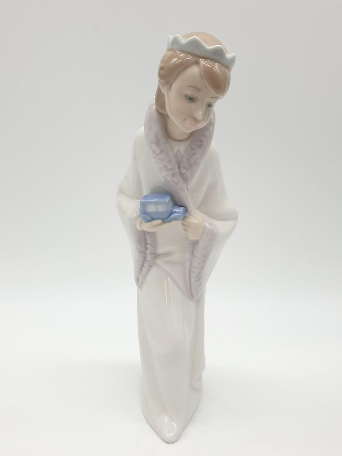Lladro statue of a young Prince holding a car. 21cm tall.