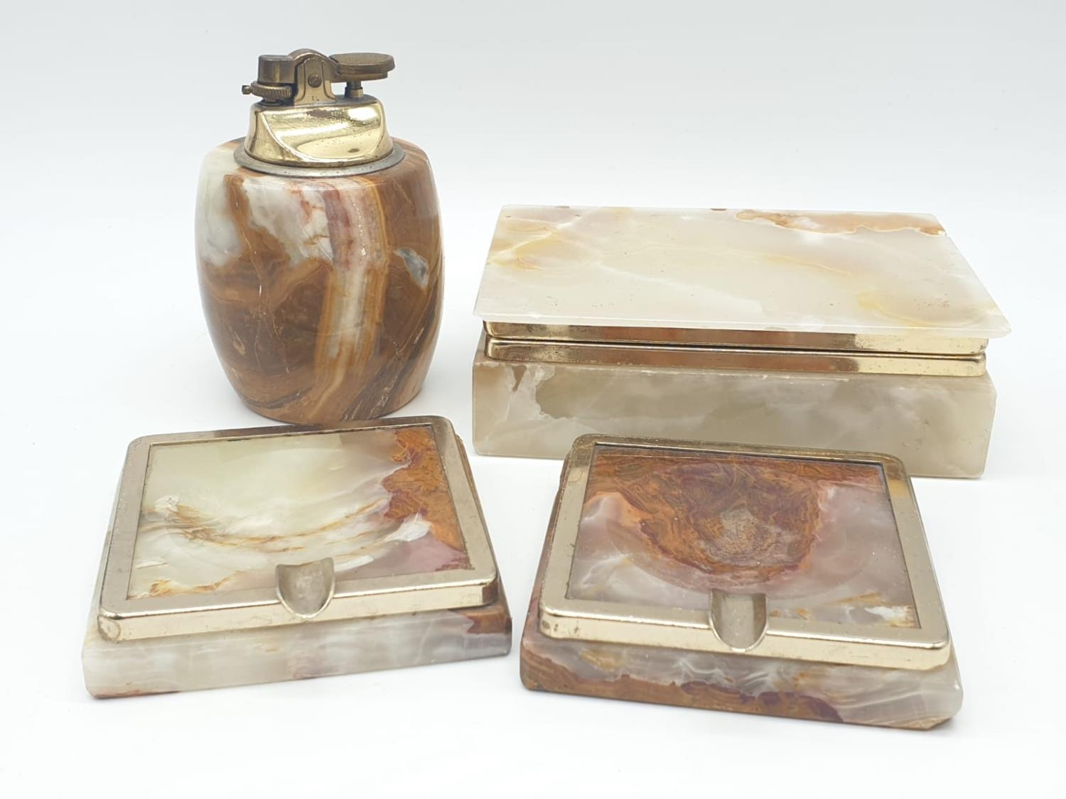An onyx cigarette box, lighter and 2 onyx ash trays (small chip on cigarette box lid).