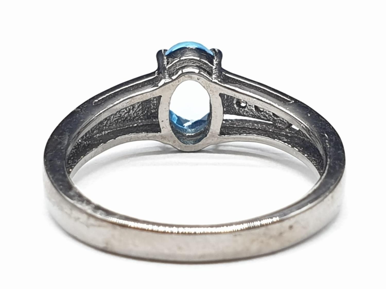0.86 Ct Blue topaz stone inset a blackened silver ring. With 0.05 Ct rose cut diamonds, weight 2.35g - Image 4 of 7