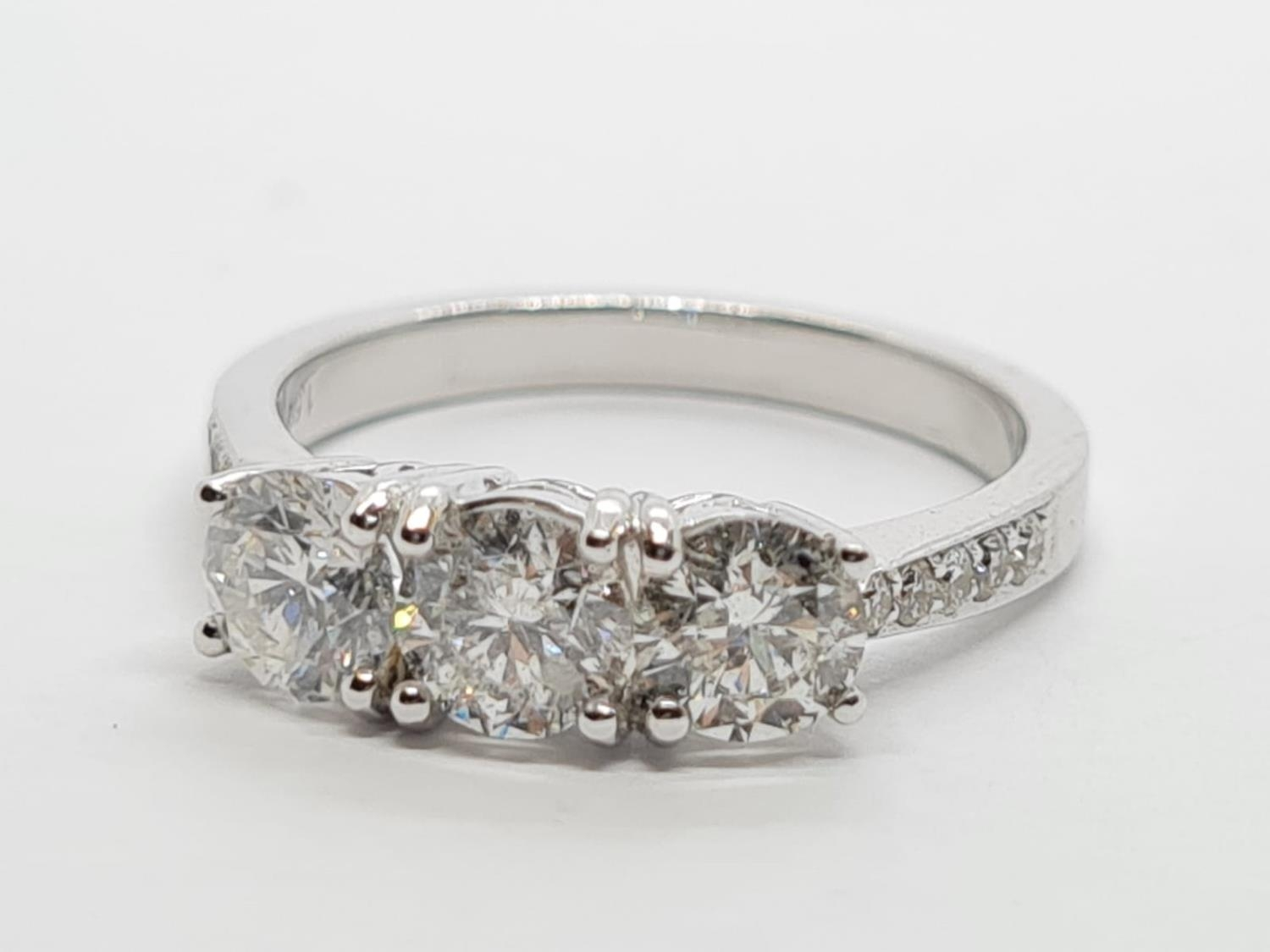 18ct White Gold with Trilogy set of 1.5ct Diamonds and further encrusted diamonds on the shoulder. - Image 2 of 6