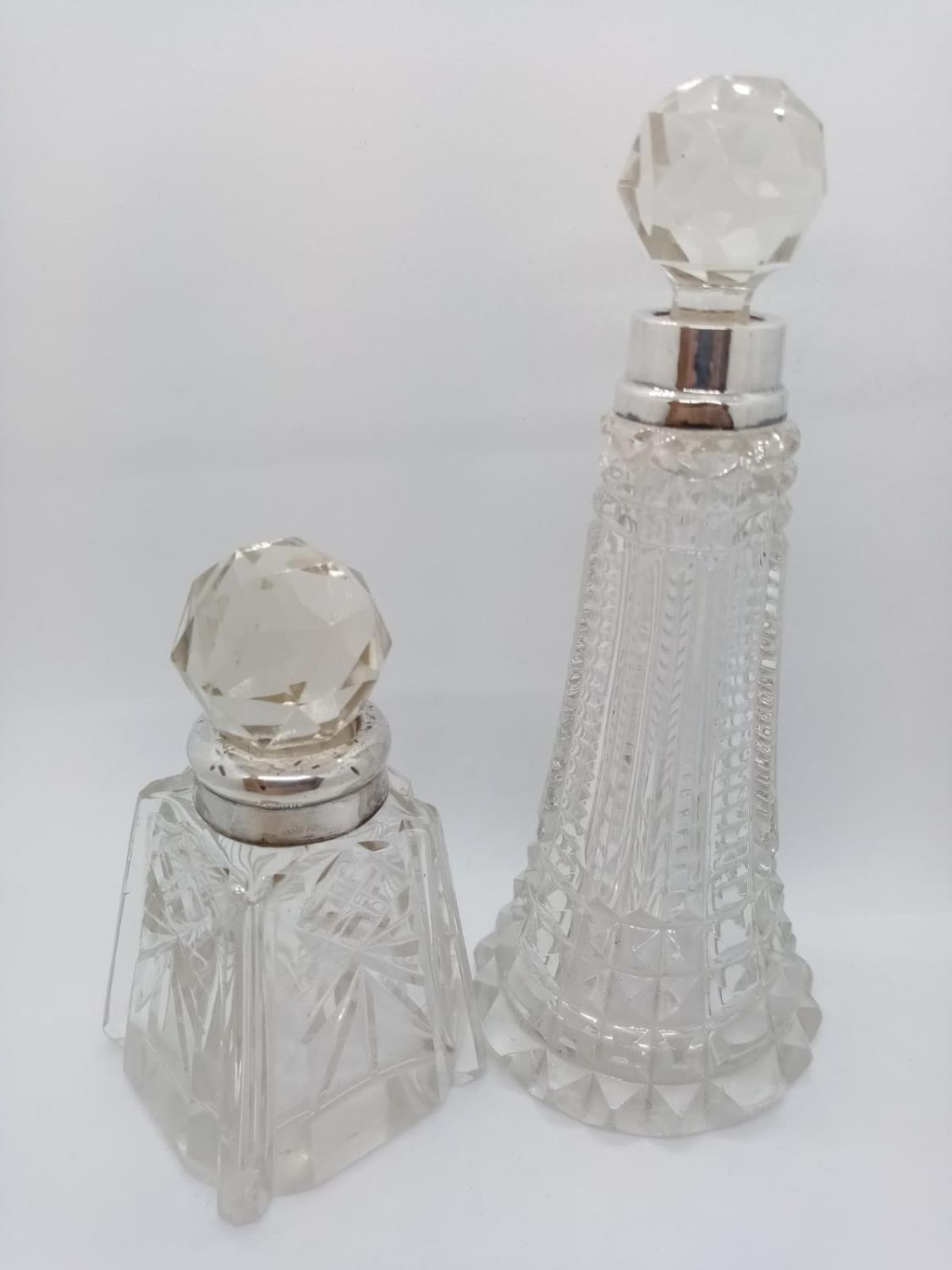 2 x Cut Glass SCENT BOTTLES. Silver Collars and also with original stoppers. Nice Art Deco style.