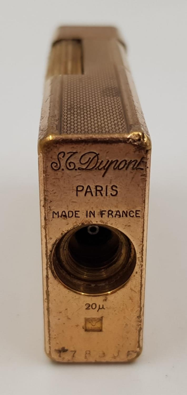A vintage gold-plated S.T Dupont lighter. - Image 3 of 3