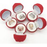 A collection of five double rings (solitaire & eternity) with various gems in velvet red rose