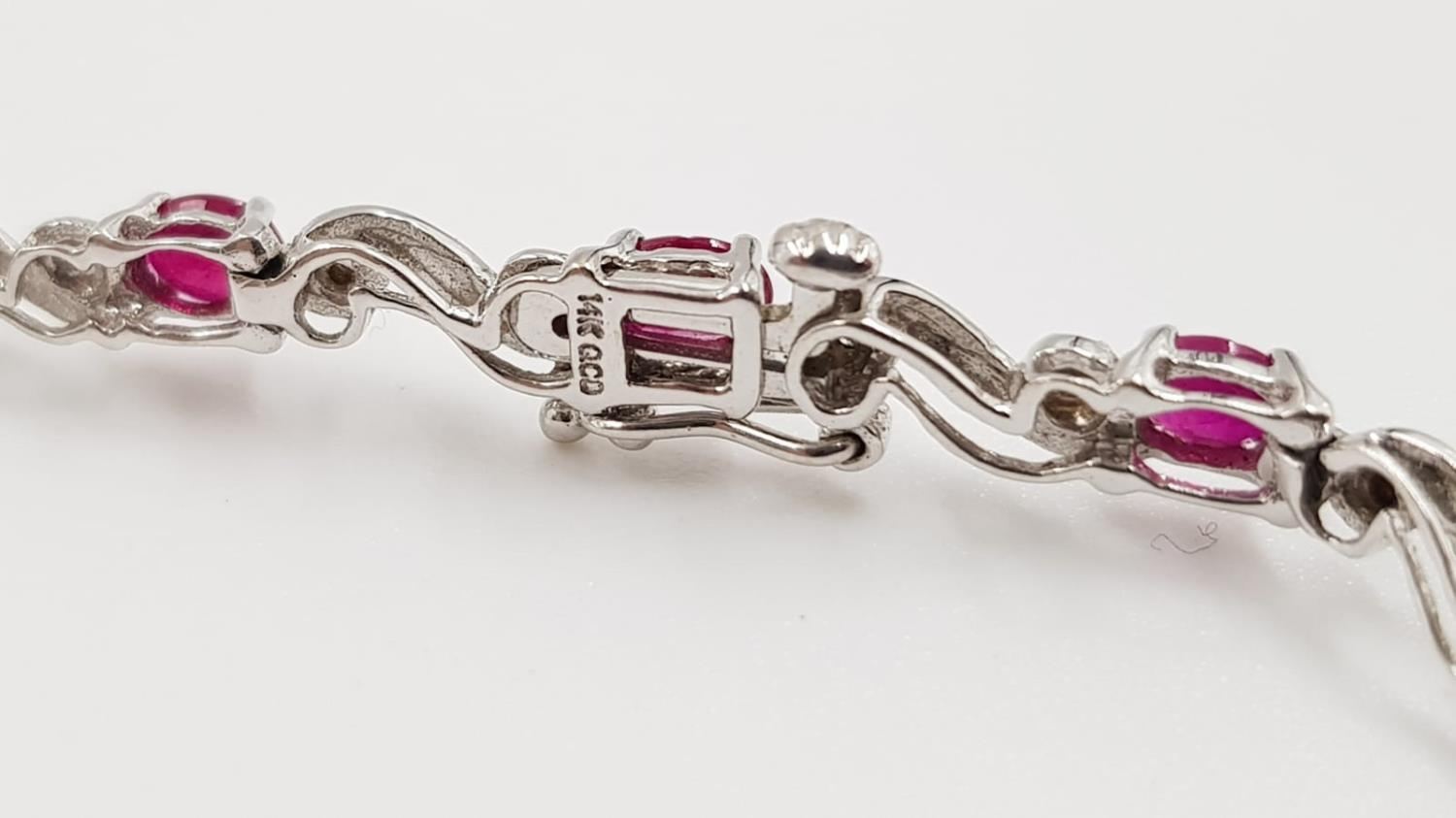 A ruby and diamond ladies bracelet on 9ct white gold. 6.2g total weight and 19cm long. - Image 3 of 3