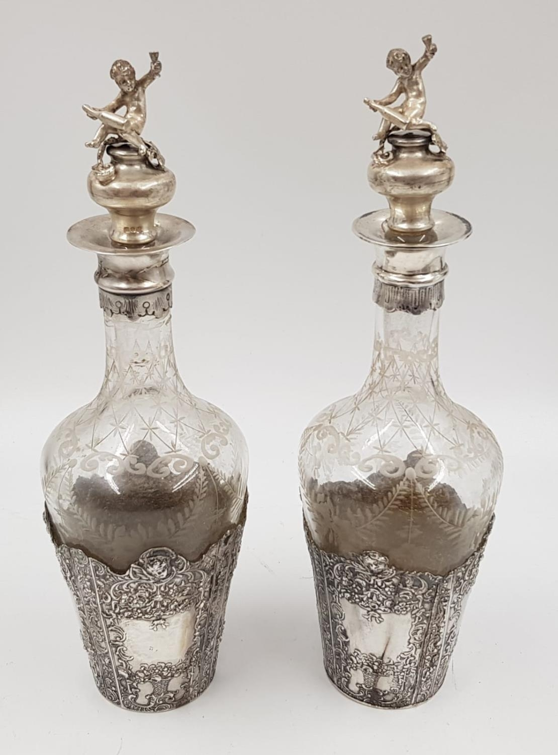 A beautiful pair of antique silver etching bottles. Dated London 1896 and imported by Berthold