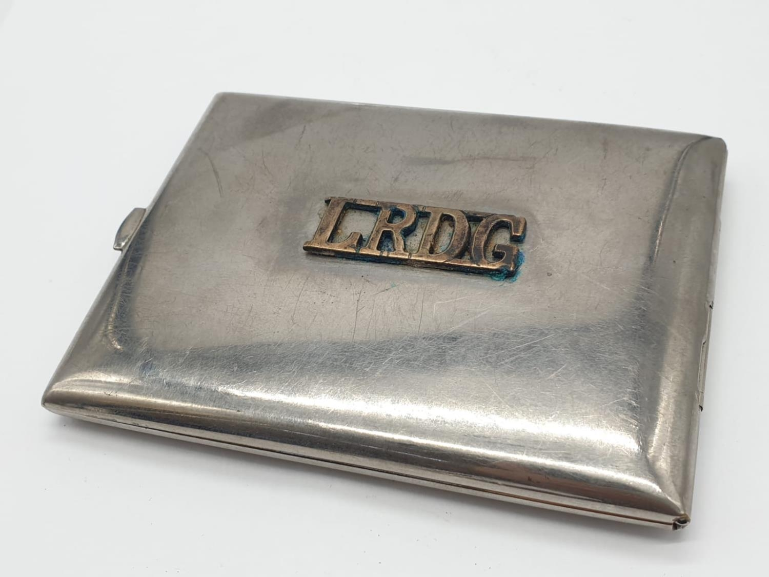 WW2 Period Cigarette Case. Hand engraved ?Egypt? and a Long Range Desert Group shoulder title