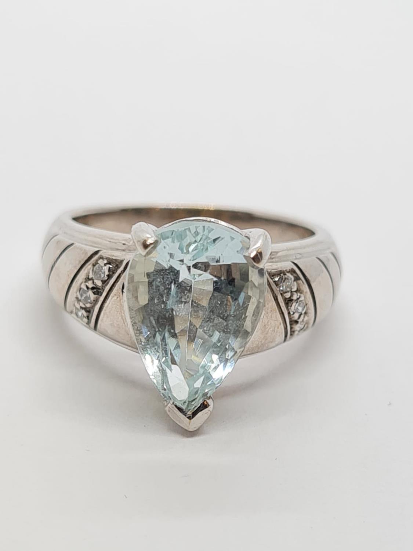 9ct White Gold Diamond and Aquamarine RING . 5.3g Size M.