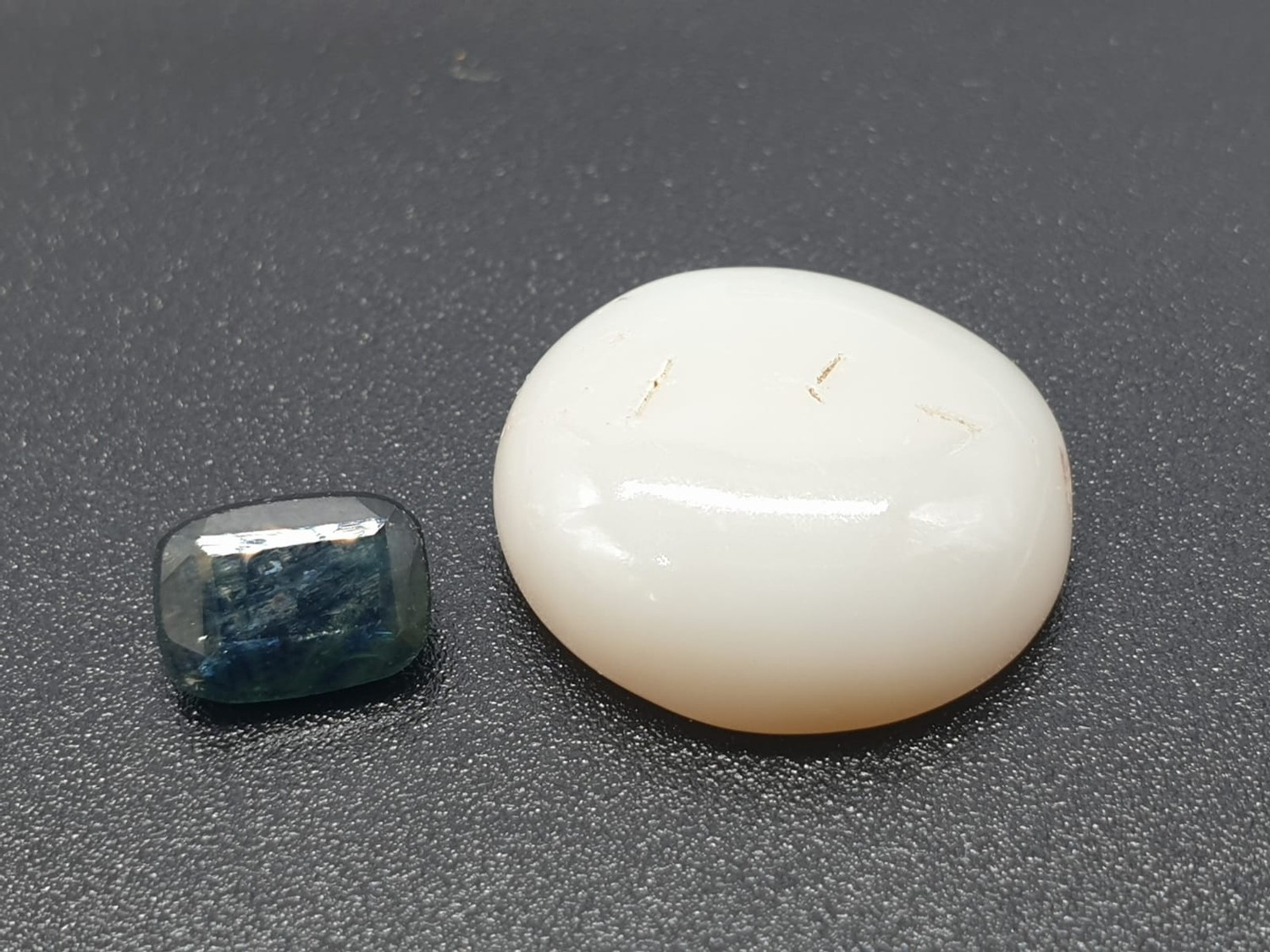1.11 Cts Natural Blue Sapphire & 6.26 Cts Natural opal. Both GJSPC Certified
