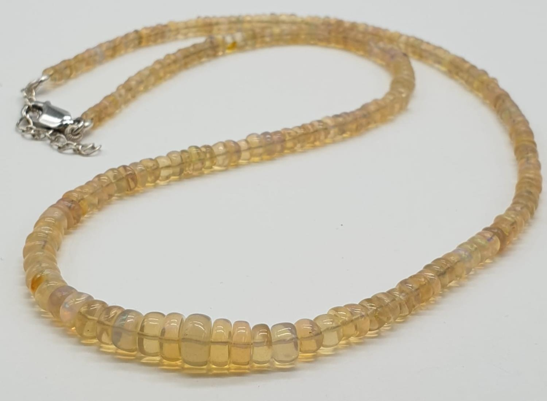 A fire opal gemstone single row necklace. Length 21cm, weight 9.16g.