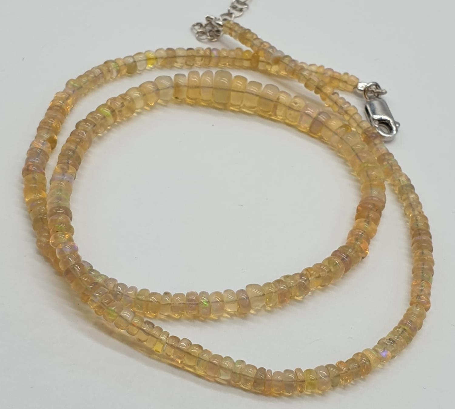 A fire opal gemstone single row necklace. Length 21cm, weight 9.16g. - Image 4 of 5