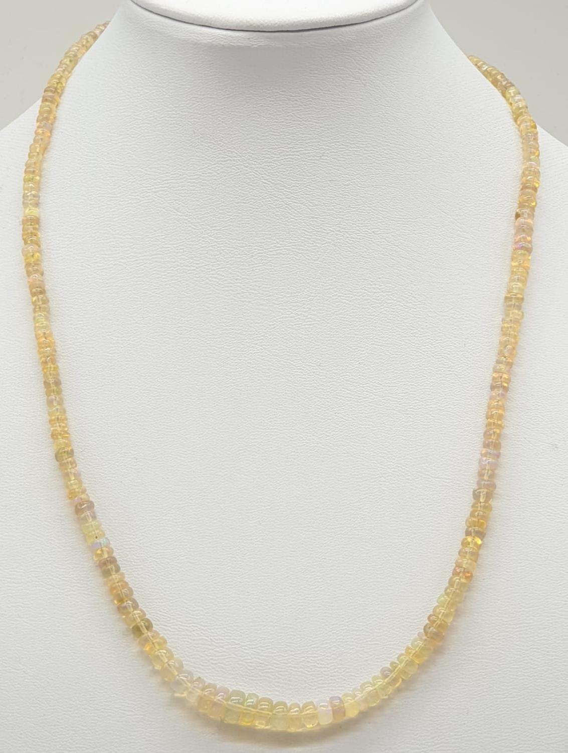 A fire opal gemstone single row necklace. Length 21cm, weight 9.16g. - Image 2 of 5