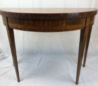 A late Victorian Semi circular table that opens up into a card table with leather top, nicely inlaid