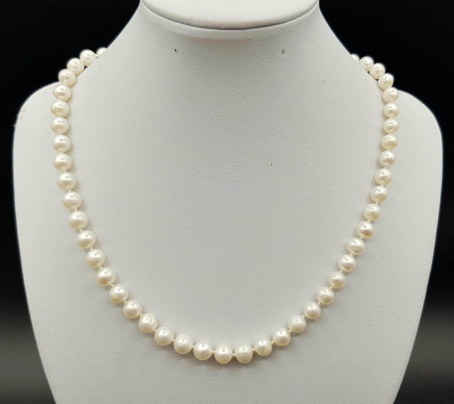 16? length string of high quality Japanese cultured pearls (7.5mm size) strung on silk with a 9