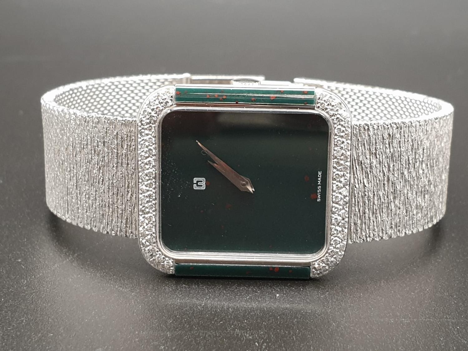 AN 18K WHITE GOLD DRESS WATCH WITH HALF DIAMOND BEZEL AND SOLID GOLD STRAP. 26MM - Image 4 of 12