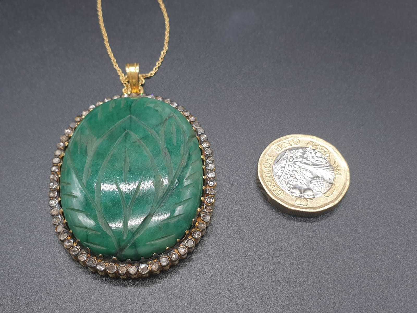 A carved emerald Pendant with a halo of rose cut diamonds in pave setting in sterling silver with - Image 5 of 7