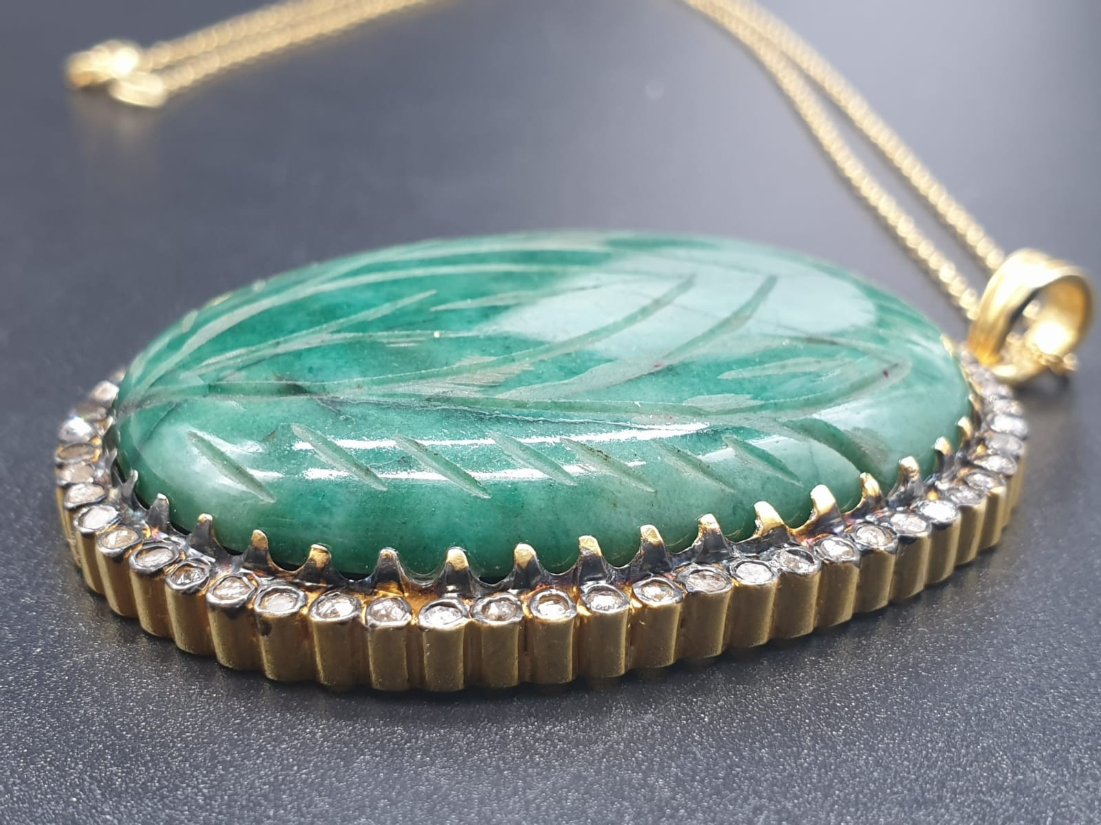 A carved emerald Pendant with a halo of rose cut diamonds in pave setting in sterling silver with - Image 4 of 7