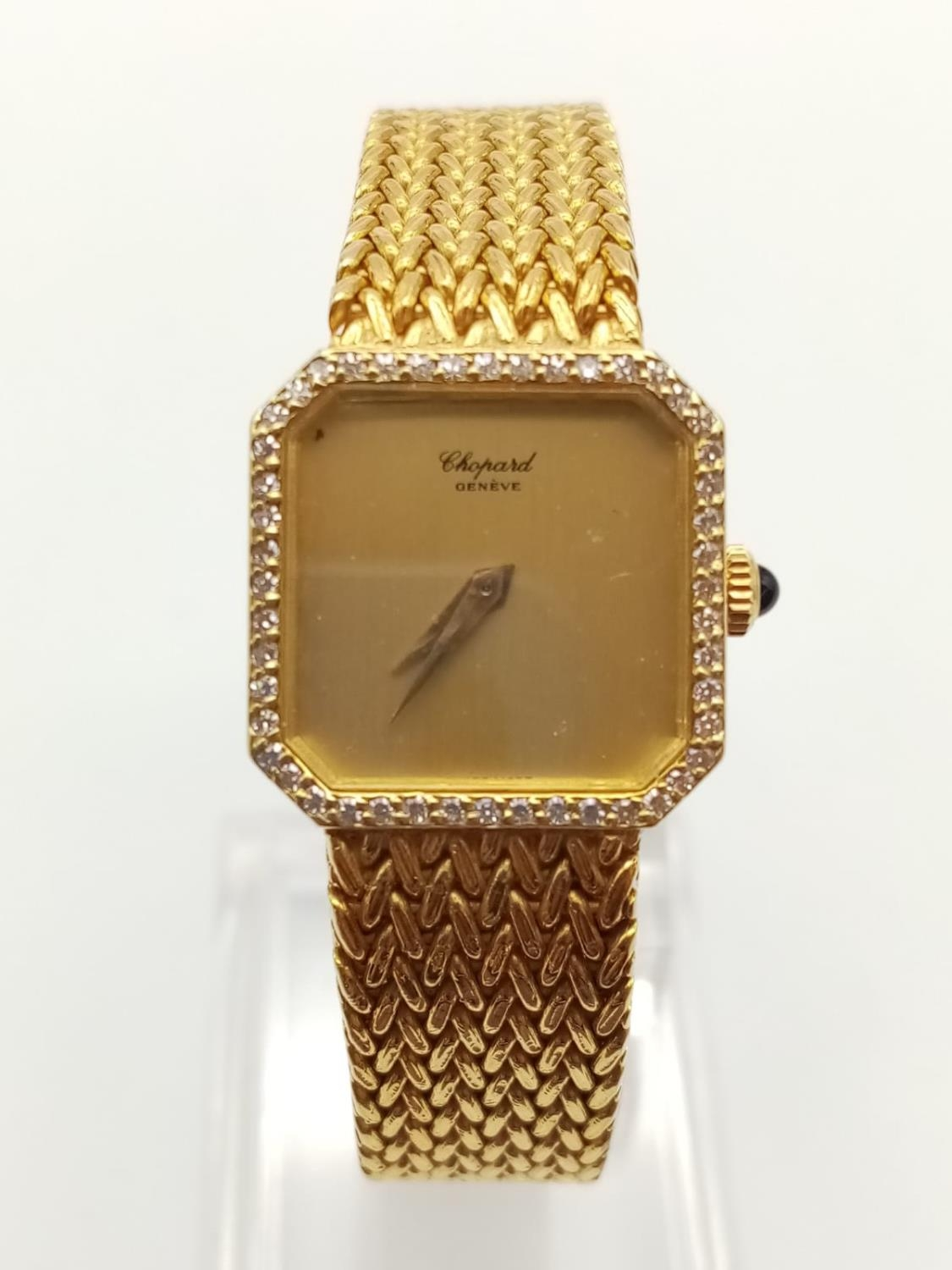 18K GOLD DRESS WATCH BY CHOPARD OF GENEVA WITH DIAMOND BEZEL AND SOLID GOLD STRAP. 20MM