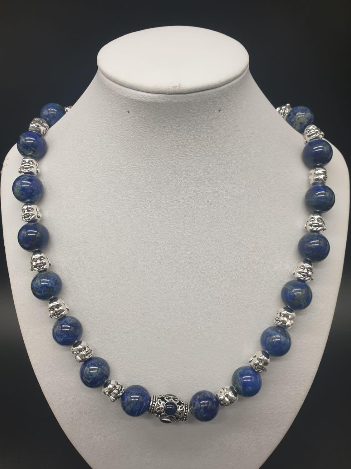 A Tibetan Buddhist lapis lazuli necklace and earrings set in a presentation box. Necklace length: - Image 2 of 11